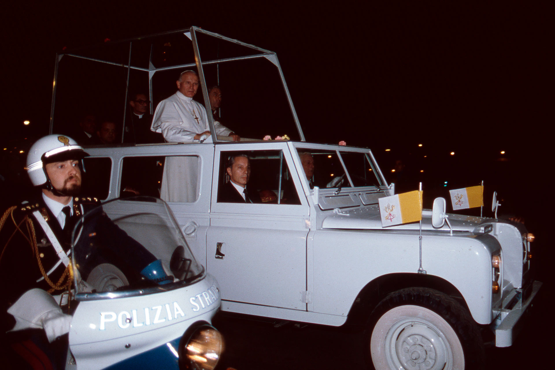 """After two very intense days of commitments, Pope Woytila, passing in Popemobile through the streets of Palermo, is transferred to the port of Palermo, where a helicopter was waiting for him to bring him to Punta Raisi airport, now named: """"Falcone and Borsellino airport""""."""